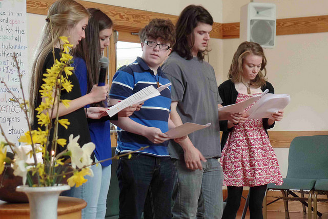 Five youth doing a reading during worship service.